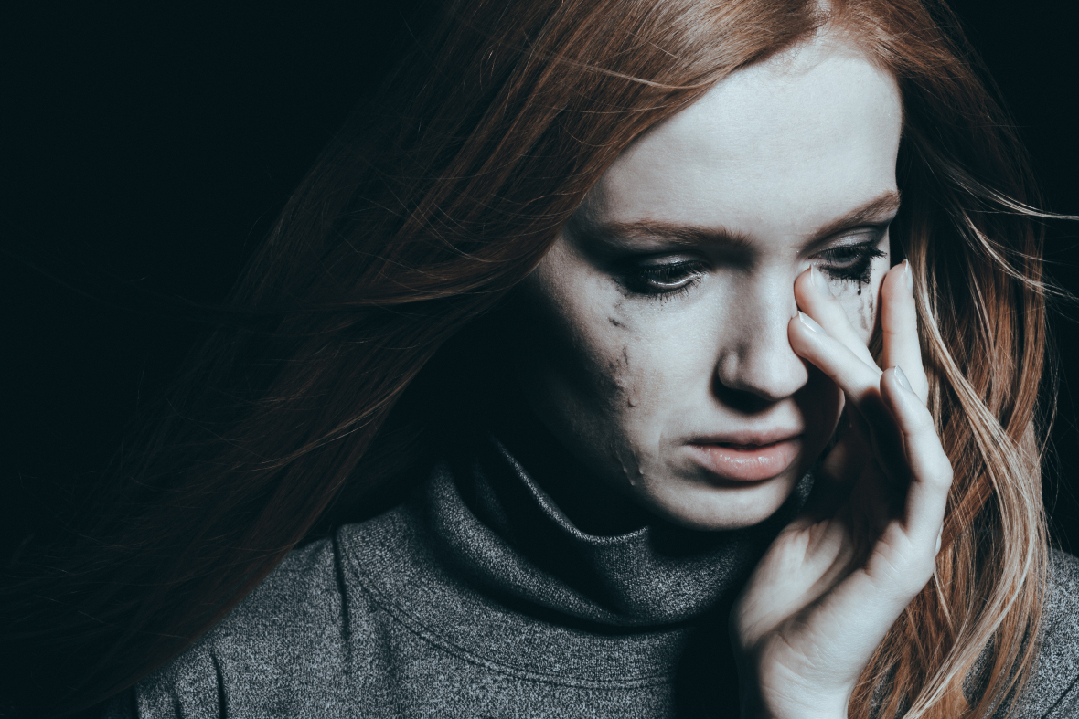 Beautiful woman covering tears