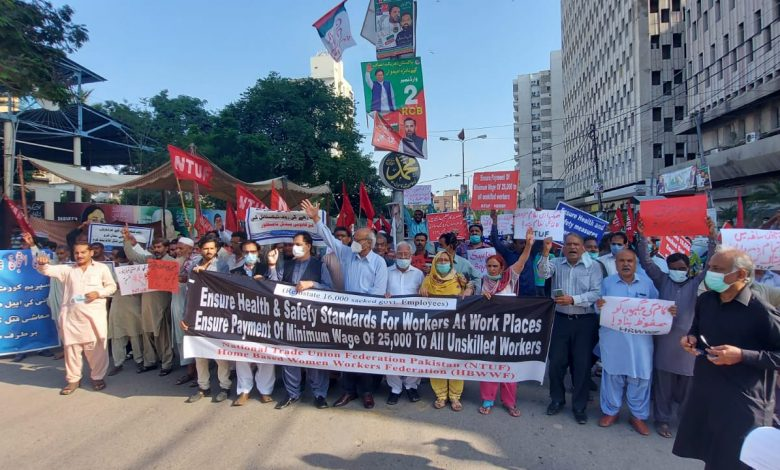 Photo of Workers stage demo for minimum wages, work place safety